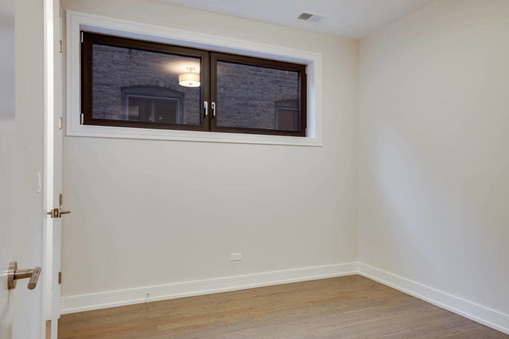 Guest bedroom at 1012 N Paulina St Unit 2, Chicago, IL