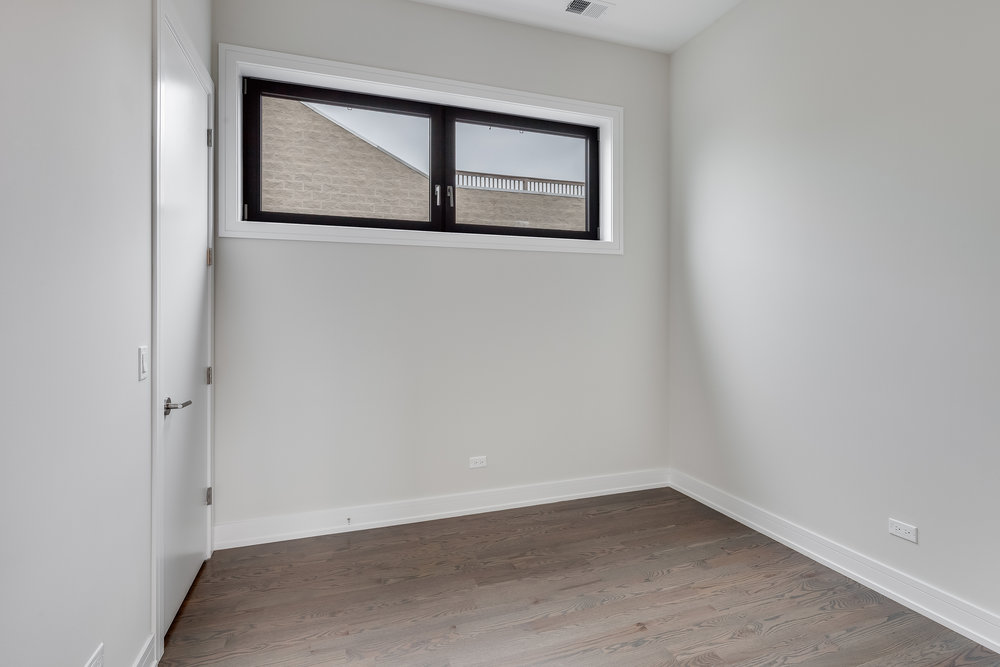 Guest bedroom at 1012 N Paulina St Unit 3, Chicago, IL