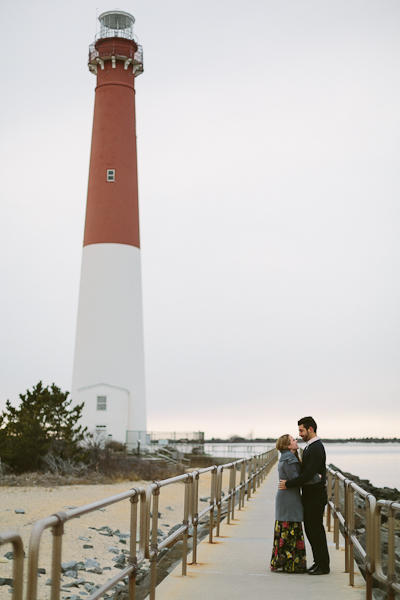 Shannon + Anthony cuddling close for their engagement session by the Barnegat Lighthouse on Long Beach Island