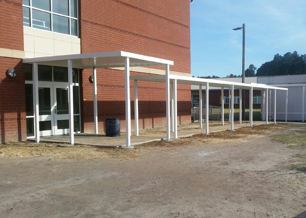 Covered Walkways - Ideal for K-12 Schools, aluminum canopies provide shaded rain-free cover for sidewalks throughout campus