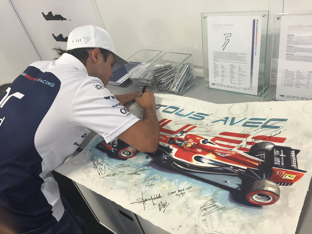 Felipe Massa signing a tribute painting 'With You' of Jules Bianchi at the USGP