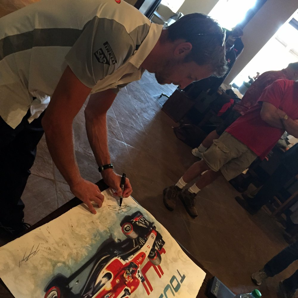 Jenson Button signing a tribute painting 'With You' of Jules Bianchi at the USGP
