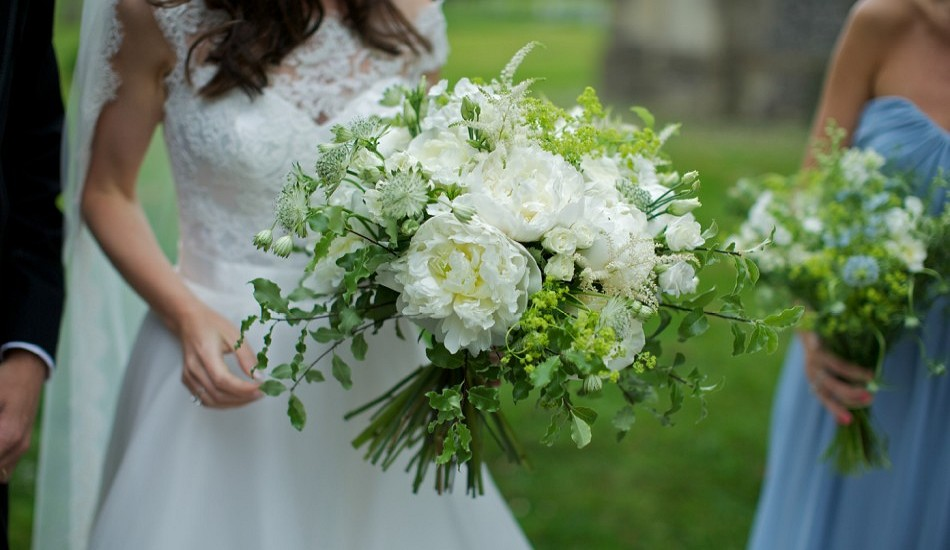 Full blown white Paeonies and heavily scented Norma Jean Roses featured in the Bride's Bouquet.