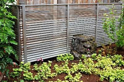 Japanese inspired cedar screen with boulder setting.