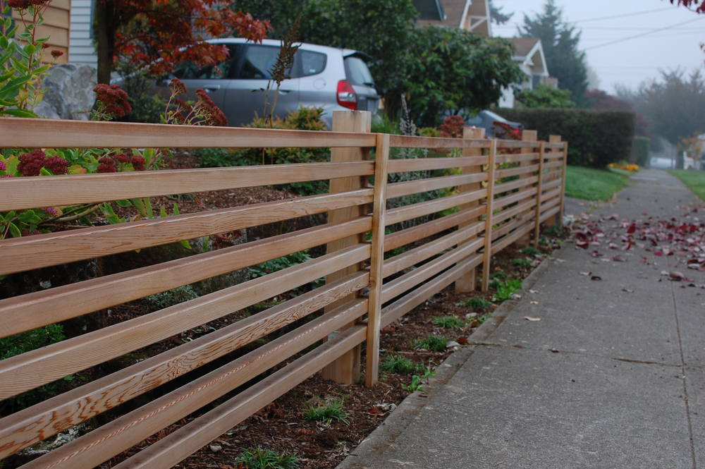 The custom cedar screening emulates bamboo fences from Japan.