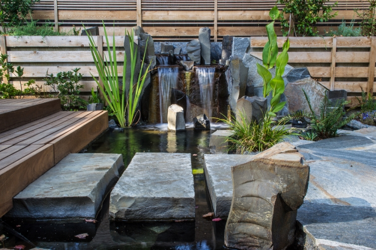 stone steps across water feature pond