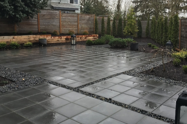 A large patio and simple plantings.