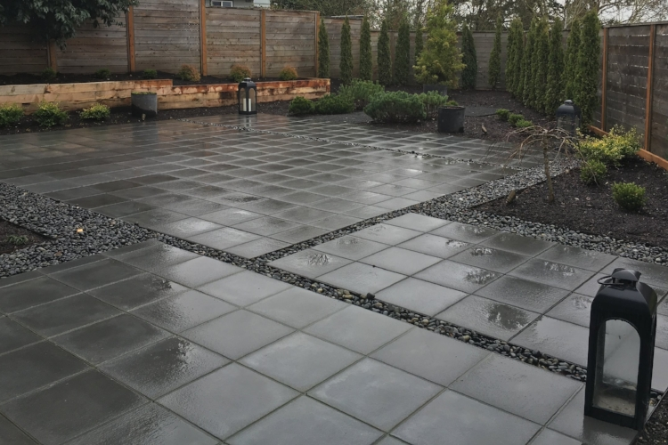 Modern paver patio eliminated about 1400 square feet of lawn.