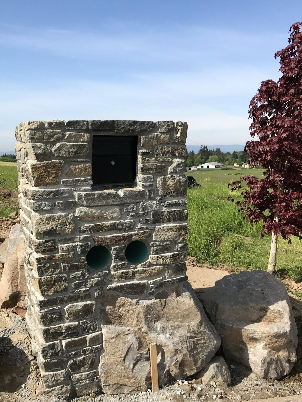 Masonry mailbox made with local basalt.