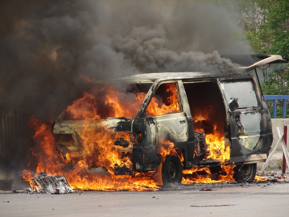 Burning van caused by a bomb.