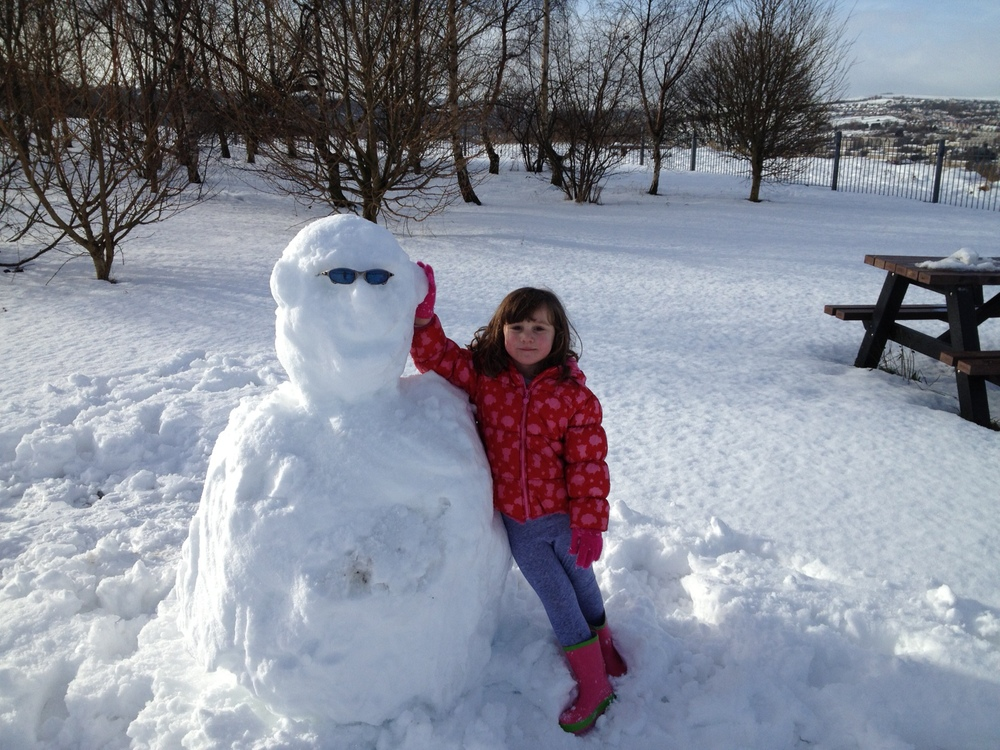 To stop my daughter crying for milk sandwiches we went out and built a snowman!