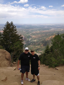 My son (in-law) Adam and me at the top (8600') of the infamous Incline in Colorado Springs, a 2100' elevation gain in 2800 steps. (Dude...)
