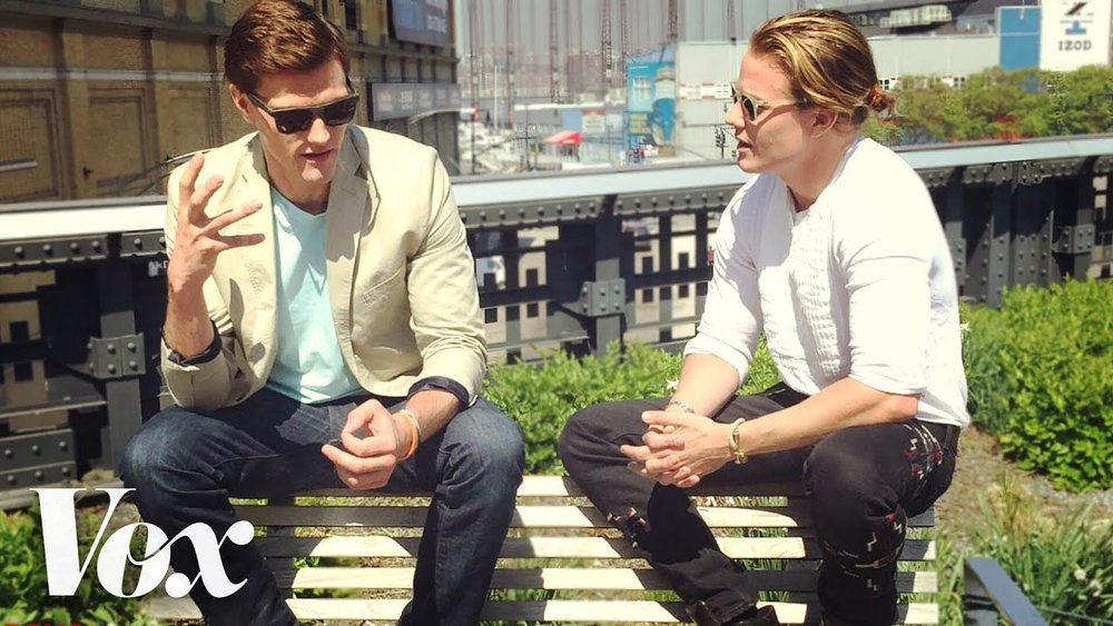 Host Hartley Sawyer and Interior Designer Ross Cassidy sitting on a bench along the High Line in New York City