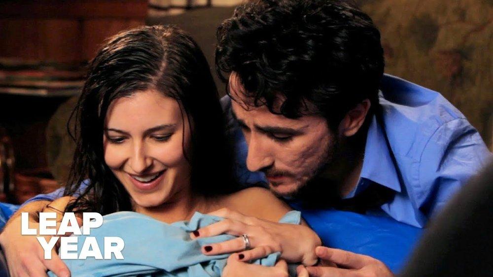 Lisa (Rachel Risen) and Aaron (Yuri Baranovsky) meeting their new baby.
