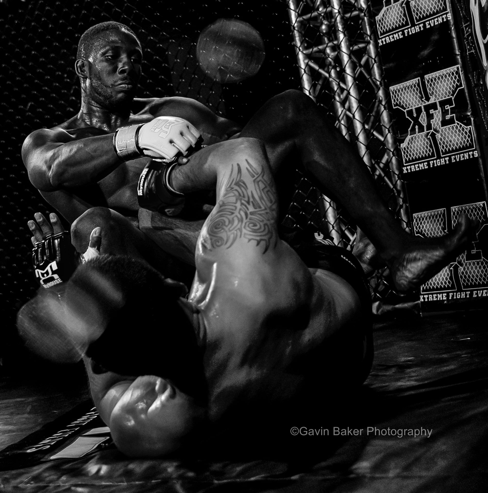 February 21, 2014: Josh Key (white gloves) sits atop Elder Ramos (black gloves)during the XFE 36 MMA event at Harrah's Philadelphia Casino in Philadelphia, PA.