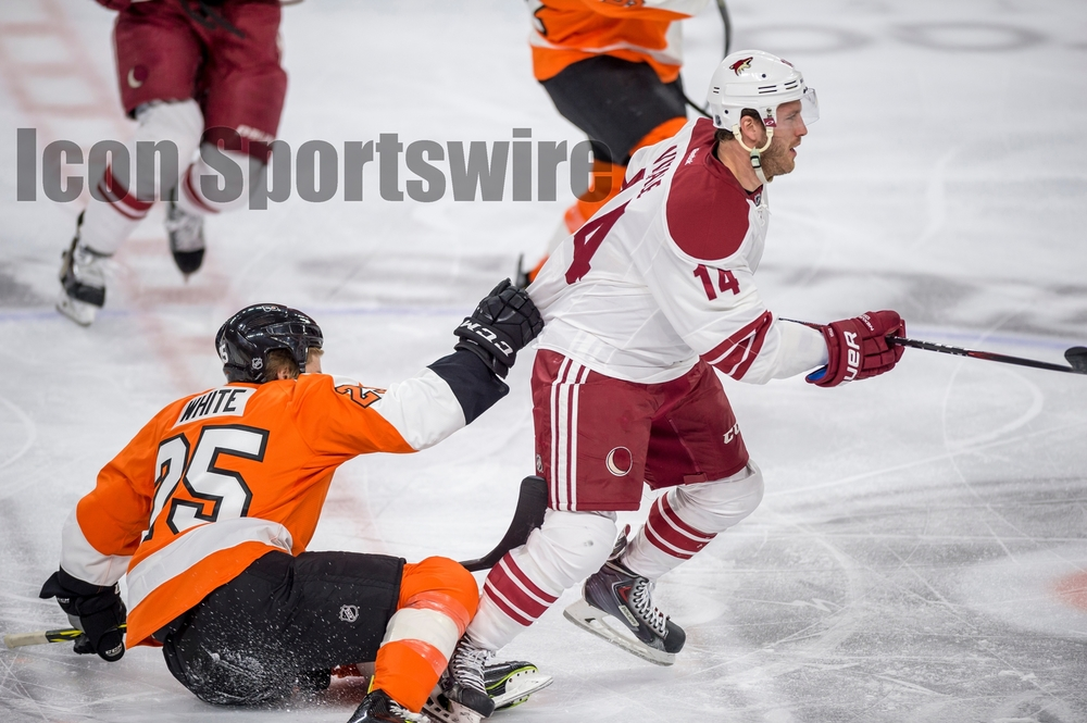 27 Jan 2015: Philadelphia Flyers center Ryan White (25) holds onto the jersey of Arizona Coyotes center Joe Vitale (14) during the NHL game between the Arizona Coyotes and the Philadelphia Flyers played at the Wells Fargo Center in Philadelphia, PA