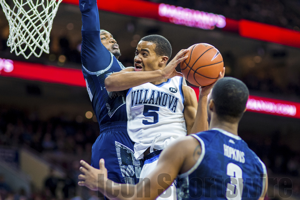 7 Feb 2015: Villanova Wildcats guard Phil Booth (5) tries to get around his defend in the air during the NCAA men's basketball game between the Georgetown Hoyas and the Villanova Wildcats played at the Wells Fargo Center in Philadelphia, PA