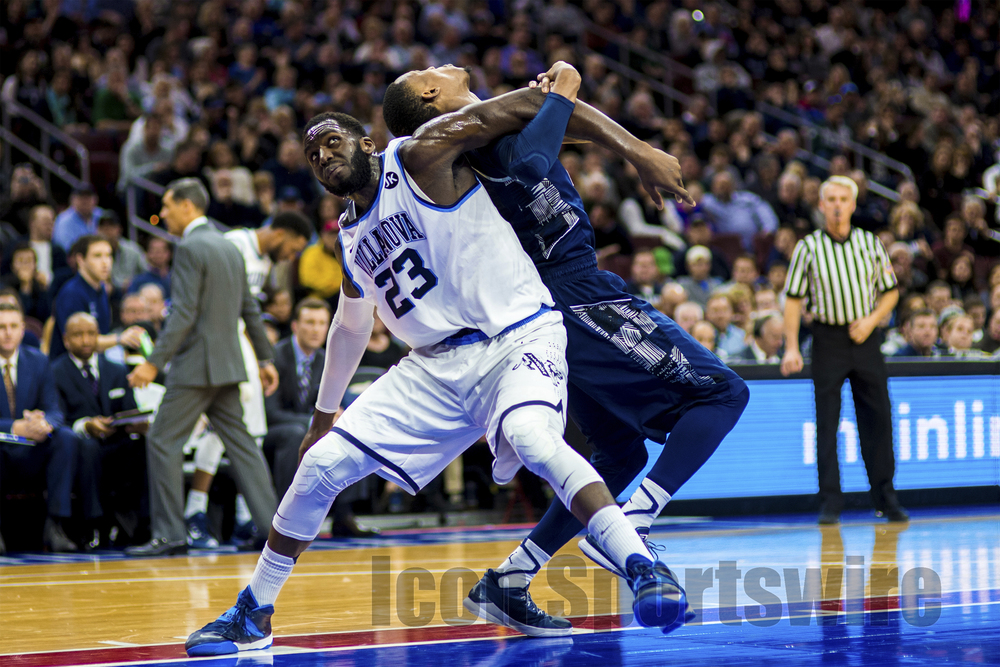7 Feb 2015: Villanova Wildcats forward Daniel Ochefu (23) holds off Georgetown Hoyas forward Aaron Bowen (23) for the rebound during the NCAA men's basketball game between the Georgetown Hoyas and the Villanova Wildcats played at the Wells Fargo Center in Philadelphia, PA