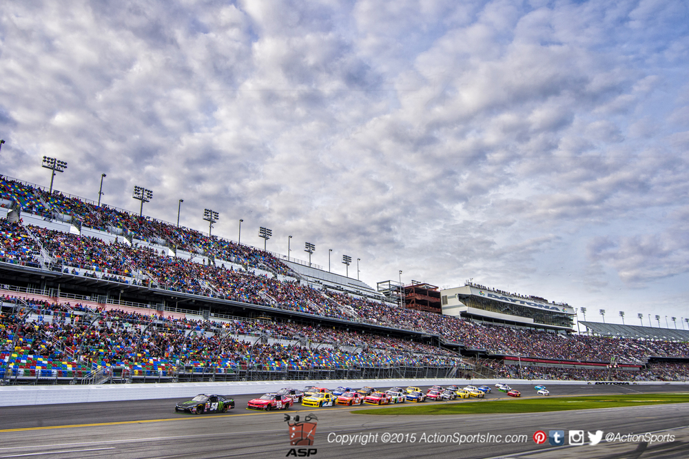 Kyle Busch (54) leads the pack along the front stretch during the Alert Today Florida 300