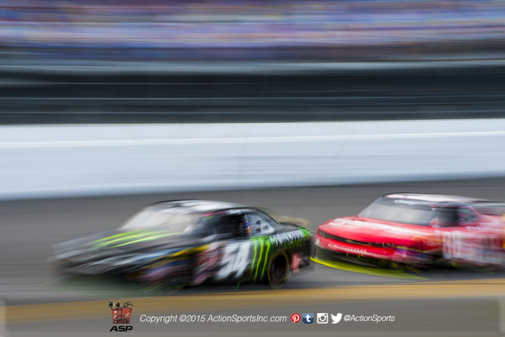 Kyle Busch (54) leads Dale Earnhardt Jr. (88) along the front stretch during the Alert Today Florida 300