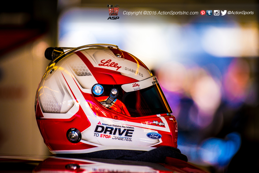The helmet ofRyan Reed (16), winner of theAlert Today Florida 300 sitsatop his racecar in the garage