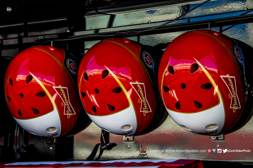 Pit crew helmets hang inside the pit box of Kevin Harvick before the Kolbalt 400at Las Vegas Motor Speedway