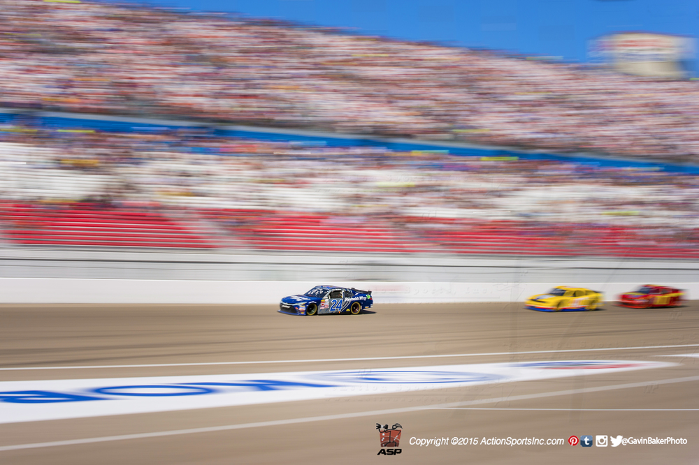 Racecars speed down the front strip at Las Vegas Motor Speedway