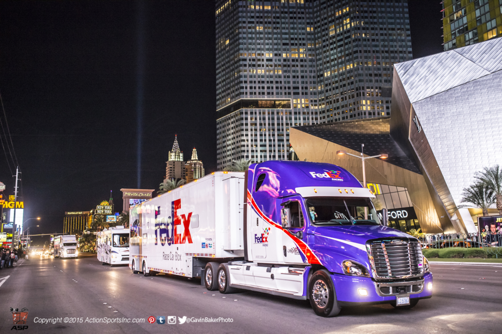 The FedEx Hauler rolls down the Las Vegas strip to deliver their  race car to Las Vegas Motor Speedway