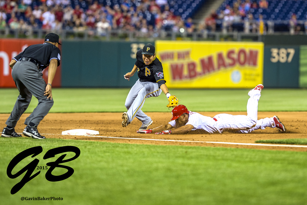 12 May 2015: Philadelphia Phillies left fielder Ben Revere (2) slides into third as Pittsburgh Pirates shortstop Jung Ho Kang (27) scrambles to tag him out during the MLB game between the Pittsburgh Pirates and the Philadelphia Phillies played at the Citizens Bank Park in Philadelphia, PA