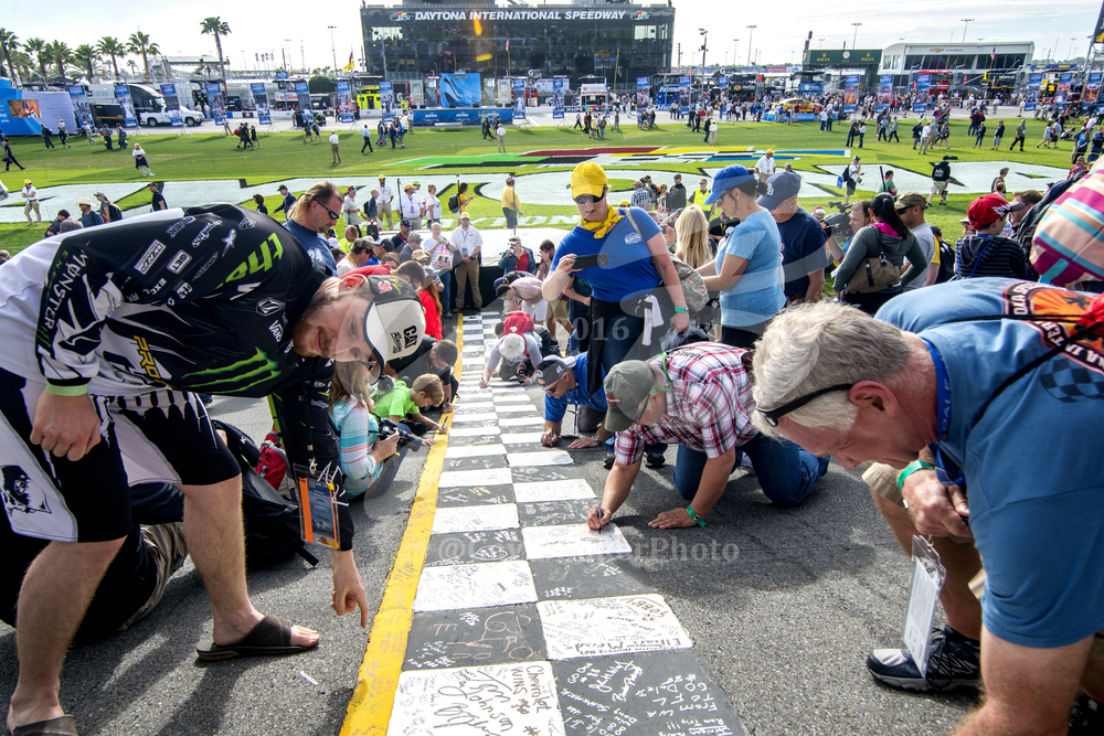 Fans write well wishes, happy birthdays, and cheers for their favorite drivers on the checkered finish line.