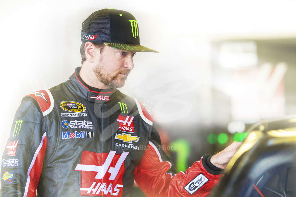 Kurt Busch gently places his hand on the Monster Energy / Haas Chevy and looks deep into the soul of the fire breathing racecar before he heads out to the track.