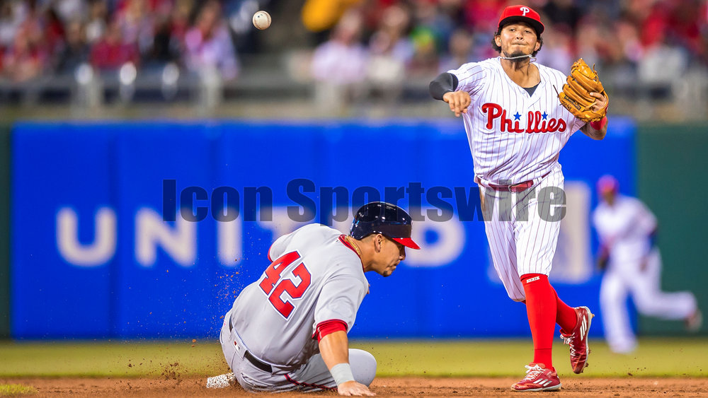 15 April 2016: Philadelphia Phillies shortstop Freddy Galvis makes the tag at second at throws to first attempting the double play during the MLB game between the Philadelphia Phillies and the Washington Nationals played at Citizens Bank Park in Philadelphia, PA. (Photo by Gavin Baker/Icon Sportswire)