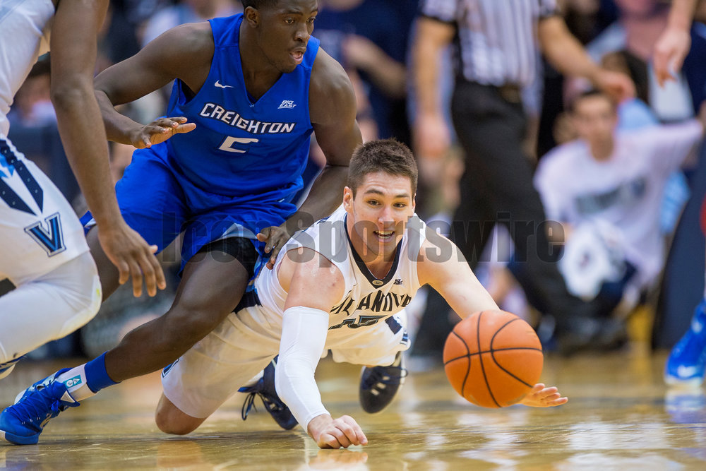 03 February 2016: Villanova Wildcats guard Ryan Arcidiacono (15) dives after the loose ball during the NCAA Baksetball game between the Villanova Wildcats and the Creighton Bluejays played at the Pavilion in Villanova, PA. (Photo by Gavin Baker/Icon Sportswire)
