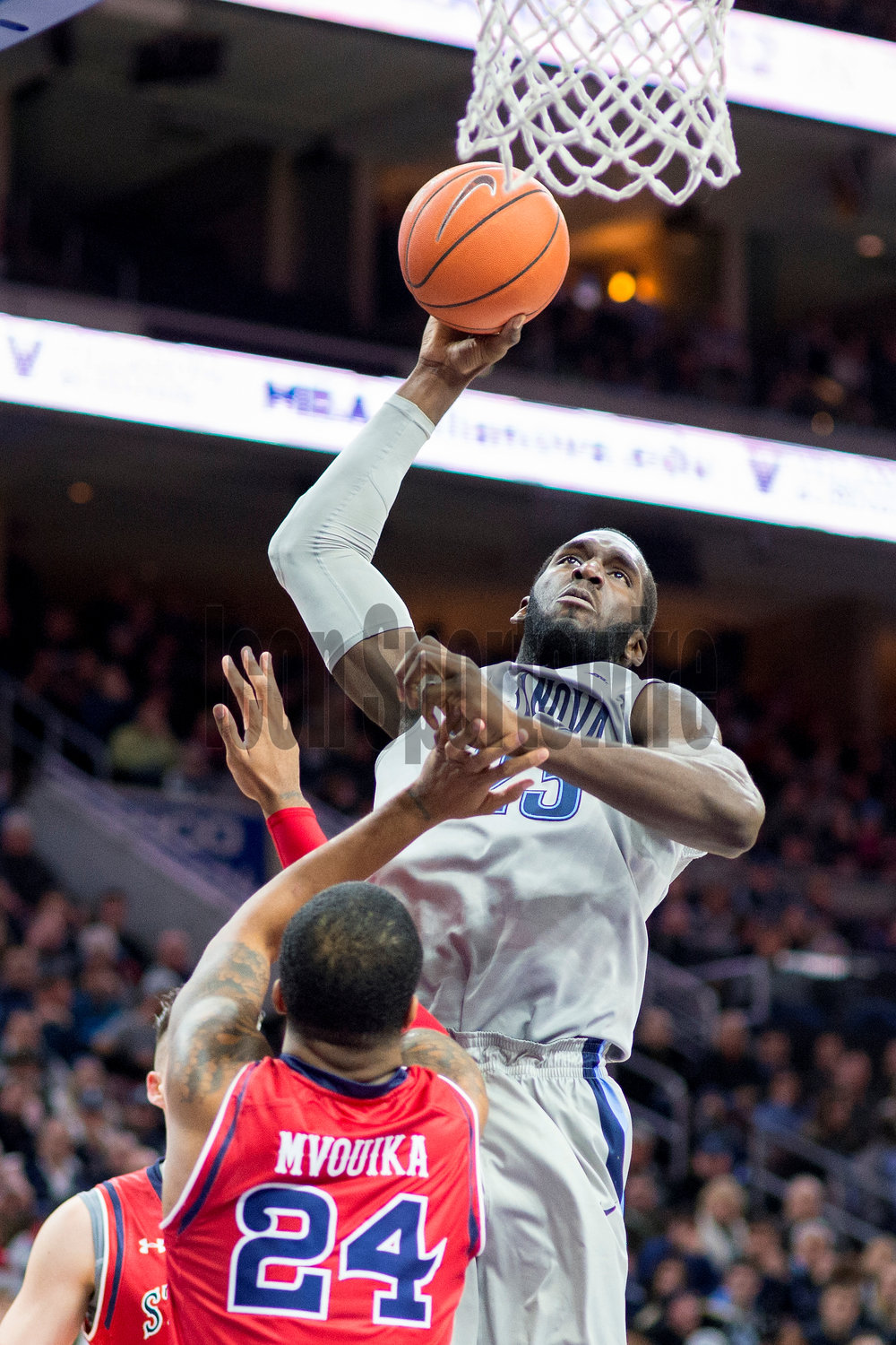 13 February 2016: Villanova Wildcats forward Daniel Ochefu (23) on the way up for his slam dunk during the NCAA basketball game between the St. John's Red Storm and the Villanova Wildcats played at the Wells Fargo Center in Philadelphia, PA. (Photo by Gavin Baker/Icon Sportswire)