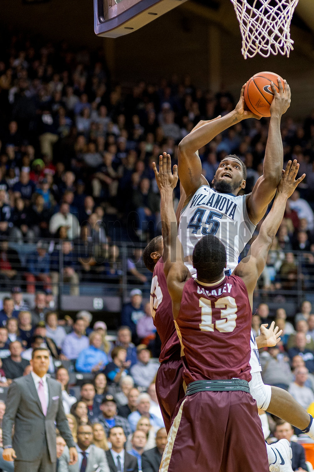 VILLANOVA, PA - NOVEMBER 23: Villanova Wildcats forward Darryl Reynolds (45) leaps over his defenders ready for the basket during the game between the Charleston Cougars and the Villanova Wildcats on November 23, 2016 at the Pavilion in Villanova PA. (Photo by Gavin Baker/Icon Sportswire)