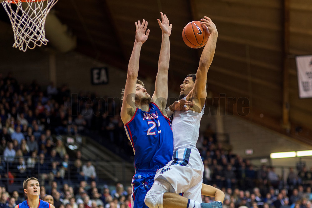 VILLANOVA, PA - DECEMBER 21: Villanova Wildcats guard Josh Hart (3) runs into his defender on the way to the basket during the game between the Villanova Wildcats and the American Eagles on December 21, 2016 at the Pavilion in Villanova PA. (Photo by Gavin Baker/Icon Sportswire)