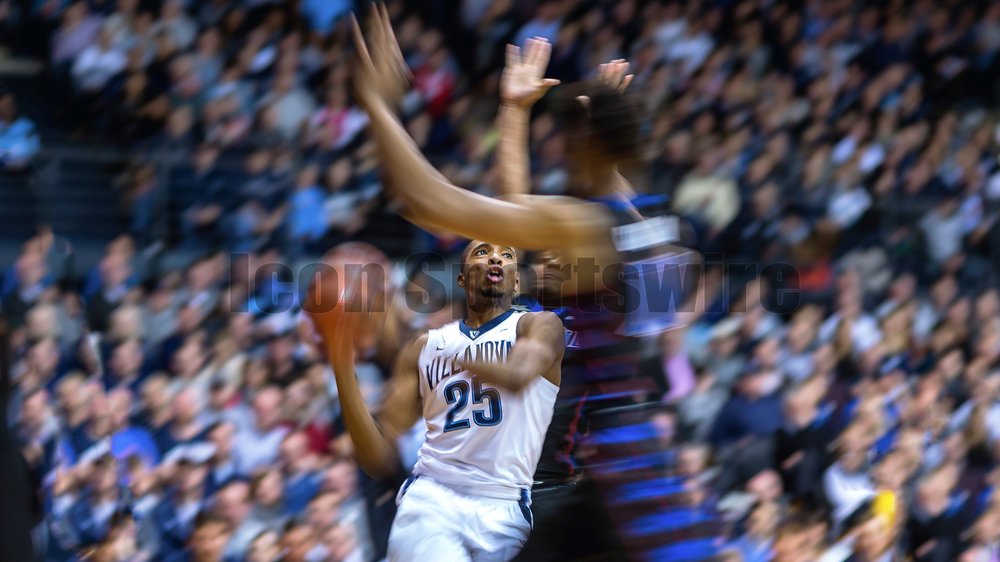 VILLANOVA, PA - DECEMBER 28:  Villanova Wildcats guard Mikal Bridges (25) charges towards the net in a blur during the game between the Villanova Wildcats and the DePaul Blue Demons on December 28, 2016 at The Pavilion in Villanova PA.(Photo by Gavin Baker/Icon Sportswire)