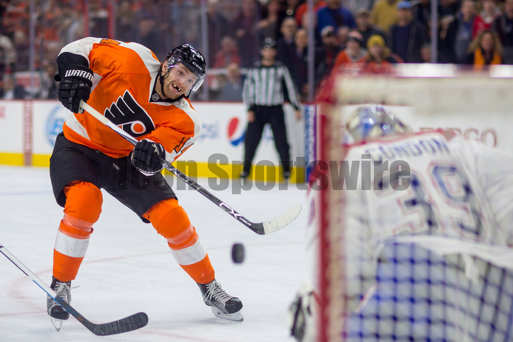 02 February 2016: Philadelphia Flyers center Sean Couturier (14) fires a shot at the goal during the NHL game between the Montreal Canadiens and the Philadelphia Flyers played at the Wells Fargo Center in Philadelphia, PA. (Photo by Gavin Baker/Icon Sportswire)