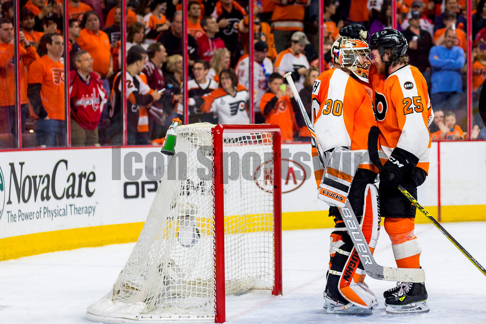 20 April 2016: Philadelphia Flyers center Ryan White (25) and Philadelphia Flyers goalie Michal Neuvirth (30) exchange elations in front of the net after winning the NHL playoff game between the Philadelphia Flyers and the Washington Capitals played at the Wells Fargo Center in Philadelphia, PA. (Photo by Gavin Baker/Icon Sportswire)
