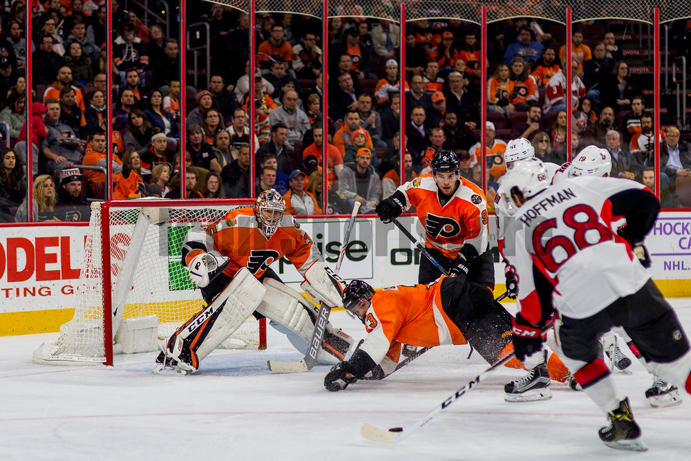 PHILADELPHIA, PA - NOVEMBER 15:  Philadelphia Flyers defenseman Radko Gudas (3) dives in front of Ottawa Senators left wing Mike Hoffman (68) while Philadelphia Flyers goalie Steve Mason (35) defends the net during the game between the Philadelphia Flyers and the Ottawa Senators on November 15, 2016, at the Wells Fargo Center in Philadelphia, PA. (Photo by Gavin Baker/Icon Sportswire)