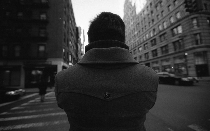 "He lives alone in a home on Utopia Parkway. I know because he told me. He tells everyone, he said. He'd struck me as odd when he was standing before me at the intersection. It was 6th Avenue and West 34th Street. The sun was out but it was cold. New York is a cold place.    He turned around and he looked at me. I think he'd heard my camera go off behind him. ""I've been waiting for you"", he said.     ""So have I"", I said.    He lives alone in a home on Utopia Parkway. He told me so I'd know. I know now that it matters. Utopia is a special place. It is warm there in the cold.    He would walk the city every day. I was to be a page in his scrap-book. Such a special book. He collected people. The city is full of people.    He wore a woolen coat and carried a cane. On his wrist was a watch with a curious face and no hands."