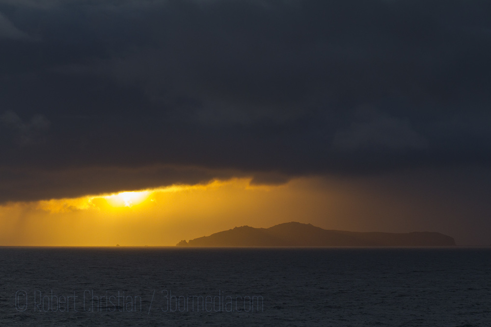 The sun sets behind the Blasket Islands.
