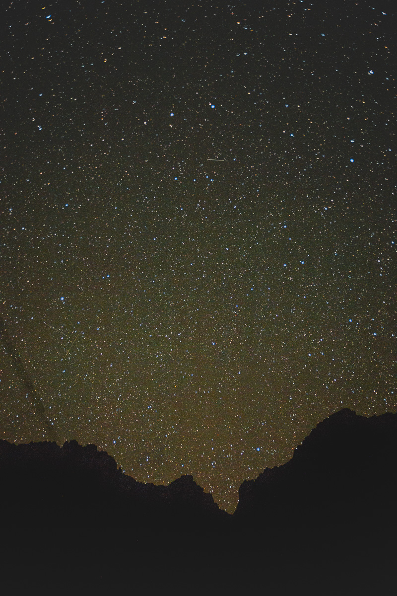 star filled sky above mountains