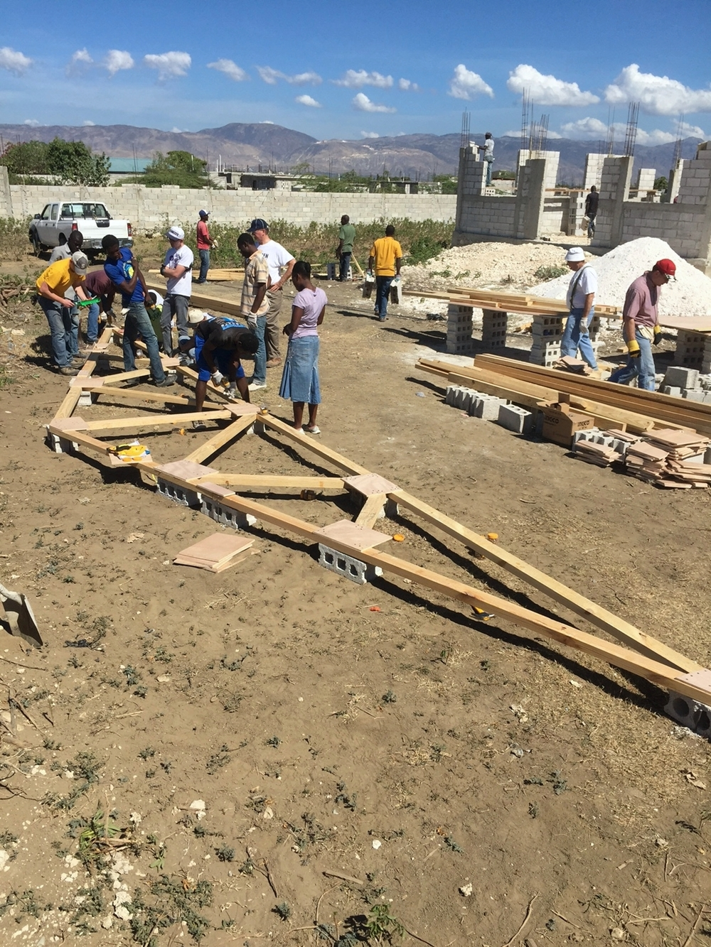 The truss forming area of the worksite with the church building in the background