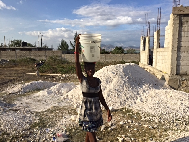 We had women and children from the congregation helping as well.  There were 4 women carrying 5 gallon buckets of water in their heads.  The water was used to mix concrete.