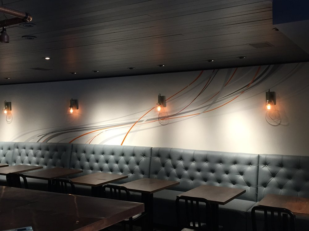Here's the dining room of Lark in the Castro. This is what I consider to be my first real mural. I had to tape off the edges of each of these sweeping lines to ensure that they'd be as sharp and perfect. The client wanted something simple and elegant with a touch of color to set off the wall.