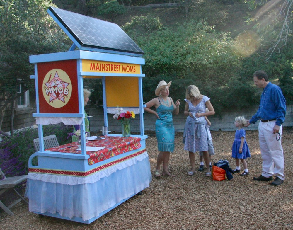 The Solar Powered Tea Trolley, a mobile platform for communications, demonstrating a renewable message.