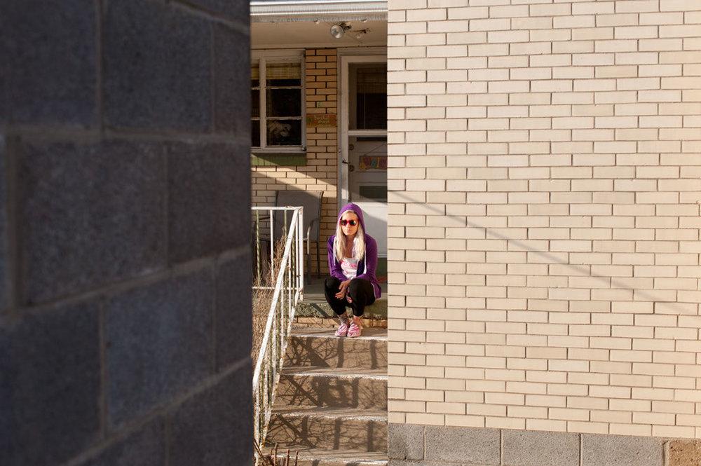 Julie on porch steps.jpg