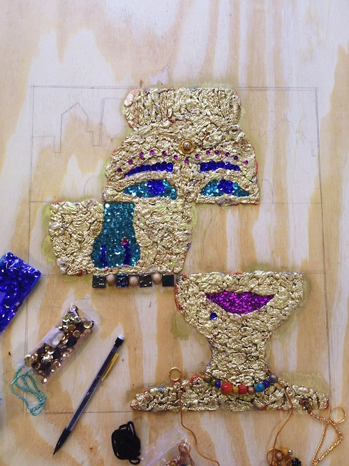 gum, spray paint, sequins, beads, wood.