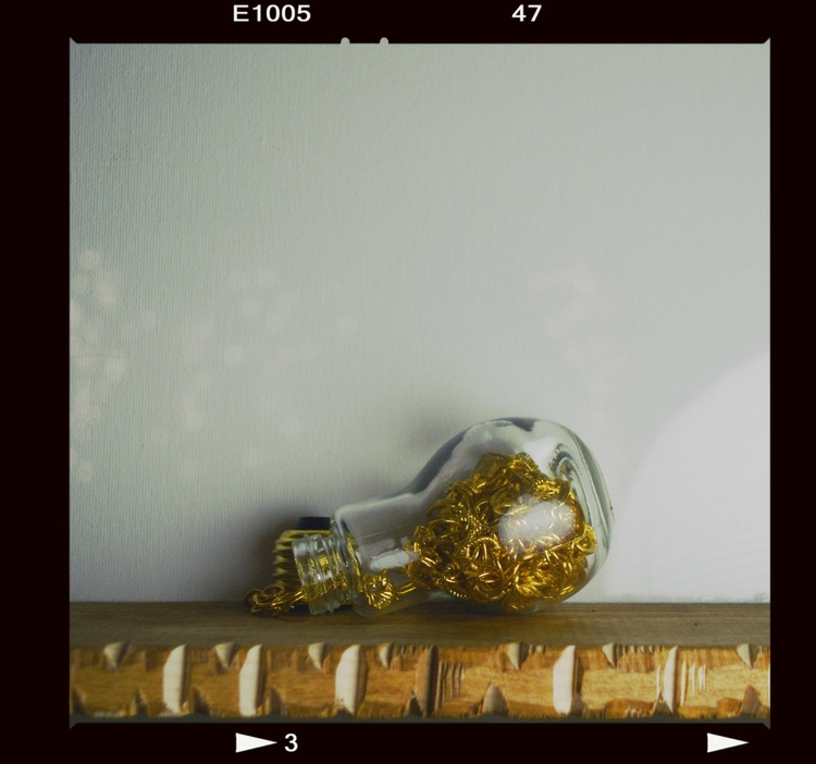 light bulb, gold chain.